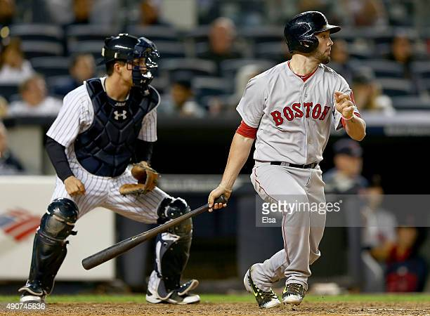 Blake Swihart of the Boston Red Sox hits a single in the 11th inning as John Ryan Murphy of the New York Yankees defends on September 30 2015 at...
