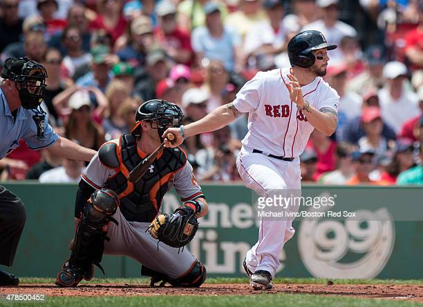 Blake Swihart of the Boston Red Sox hits an RBI single during the second inning against the Baltimore Orioles at Fenway Park in Boston Massachusetts...