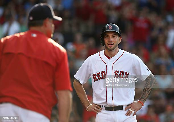 Blake Swihart of the Boston Red Sox looks at Red Sox Manager John Farell in the sixth inning during the game against the Toronto Blue Jays at Fenway...