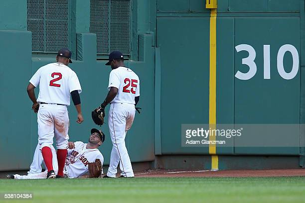 Blake Swihart of the Boston Red Sox looks on after injuring himself in the seventh inning during the game against the Tornoto Blue Jays at Fenway...