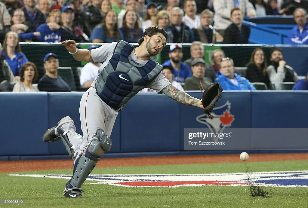 Blake Swihart #23 of the Boston Red Sox misplays a foul pop up in the seventh inning during MLB game action against the Toronto Blue Jays on April 9, 2016 at Rogers Centre in Toronto, Ontario, Canada.