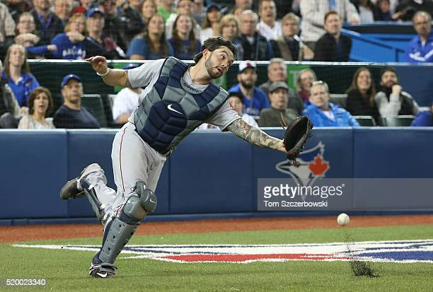 Blake Swihart of the Boston Red Sox misplays a foul pop up in the seventh inning during MLB game action against the Toronto Blue Jays on April 9 2016...