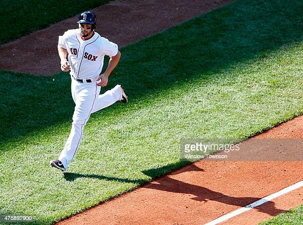 Blake Swihart of the Boston Red Sox rounds the bases after his solo home run during the third inning of the game against the Minnesota Twins at...