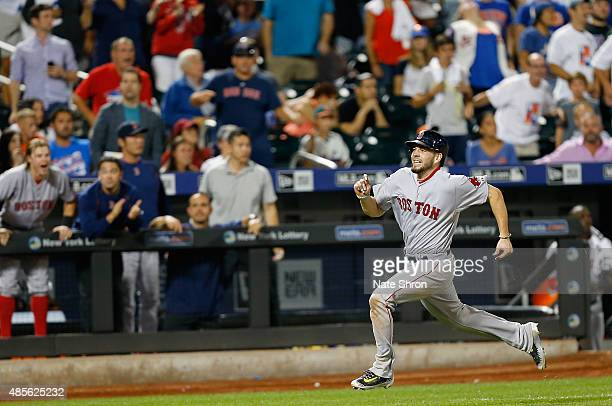 Blake Swihart of the Boston Red Sox runs the bases as he hits an inside the park home run in the tenth inning against the New York Mets on August 28...