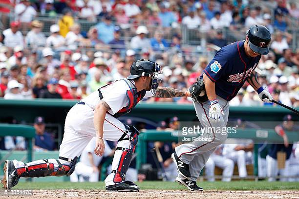 Blake Swihart of the Boston Red Sox tags out Byung Ho Park of the Minnesota Twins after a strikeout in the third inning of a spring training game at...
