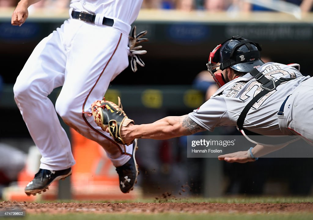 Blake Swihart #23 of the Boston Red Sox tags out Kurt Suzuki #8 of the Minnesota Twins at home plate during the sixth inning of the game on May 25, 2015 at Target Field in Minneapolis, Minnesota. The Twins defeated the Red Sox 7-2.