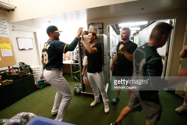 Blake Treinen and Sonny Gray of the Oakland Athletics celebrate in the clubhouse following the game against the Tampa Bay Rays at the Oakland Alameda...