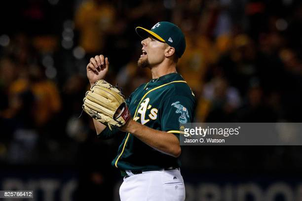 Blake Treinen of the Oakland Athletics celebrates after the game against the San Francisco Giants at the Oakland Coliseum on July 31 2017 in Oakland...