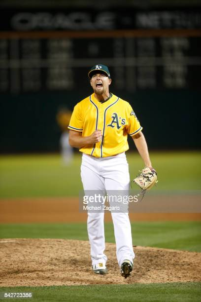 Blake Treinen of the Oakland Athletics celebrates on the field following the game against the Kansas City Royals at the Oakland Alameda Coliseum on...