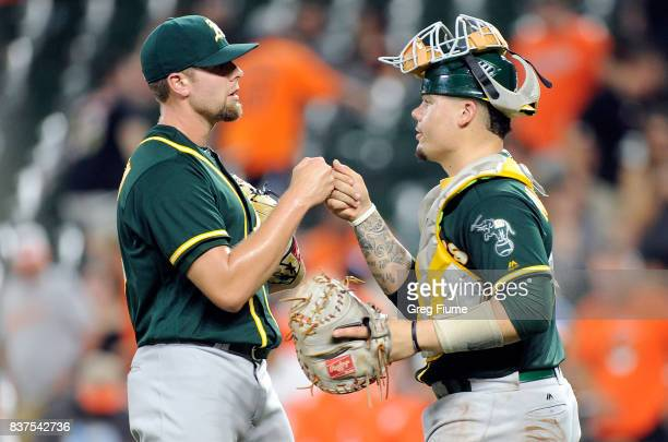 Blake Treinen of the Oakland Athletics celebrates with Bruce Maxwell after a 64 victory against the Baltimore Orioles at Oriole Park at Camden Yards...