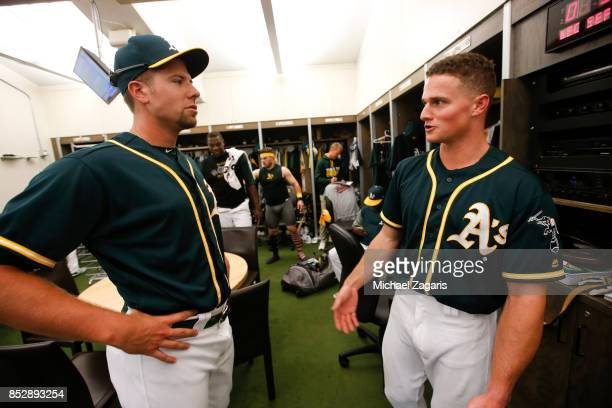 Blake Treinen of the Oakland Athletics gets an explanation from Matt Chapman about Chapman's ejected in the clubhouse following the game against the...