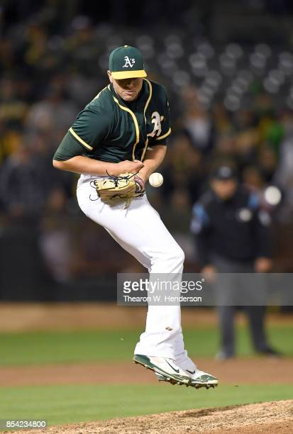 Blake Treinen of the Oakland Athletics gets hit with a batted ball off the bat of Brett Nicholas of the Texas Rangers in the top of the ninth inning...