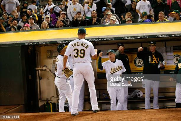 Blake Treinen of the Oakland Athletics is greeted at the dugout during the game against the Tampa Bay Rays at the Oakland Alameda Coliseum on July 18...