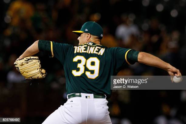 Blake Treinen of the Oakland Athletics pitches against the San Francisco Giants during the ninth inning at the Oakland Coliseum on July 31 2017 in...