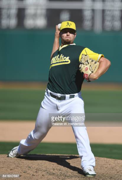 Blake Treinen of the Oakland Athletics pitches against the Texas Rangers in the top of the ninth inning at Oakland Alameda Coliseum on August 27 2017...