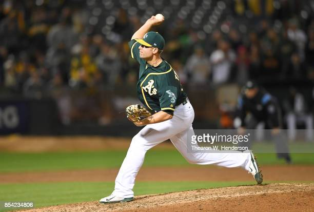 Blake Treinen of the Oakland Athletics pitches against the Texas Rangers in the top of the ninth inning at Oakland Alameda Coliseum on September 22...