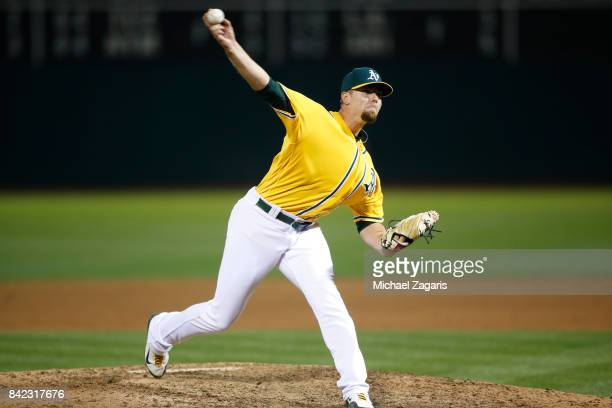 Blake Treinen of the Oakland Athletics pitches during the game against the Seattle Mariners at the Oakland Alameda Coliseum on August 8 2017 in...