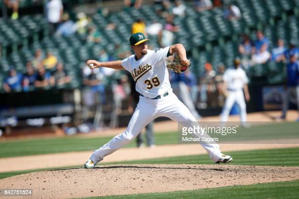 Blake Treinen of the Oakland Athletics pitches during the game against the Kansas City Royals at the Oakland Alameda Coliseum on August 16 2017 in...