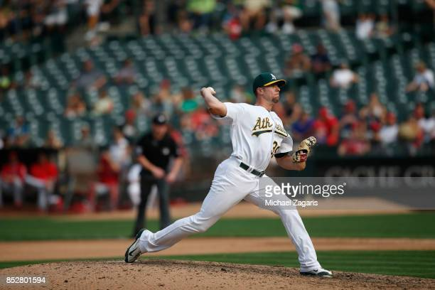 Blake Treinen of the Oakland Athletics pitches during the game against the Los Angeles Angels of Anaheim at the Oakland Alameda Coliseum on September...