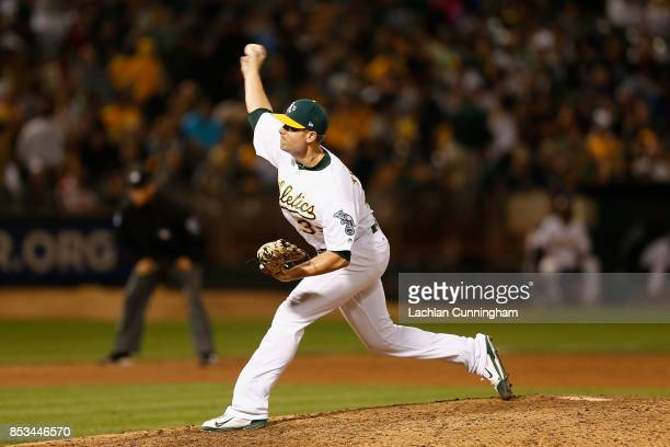 Blake Treinen of the Oakland Athletics pitches in the ninth inning against the Texas Rangers at Oakland Alameda Coliseum on September 23 2017 in...