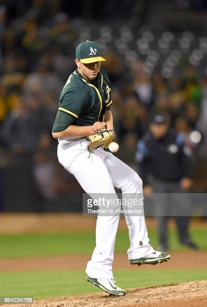 Blake Treinen of the Oakland Athletics reacts getting hit with a batted ball off the bat of Brett Nicholas of the Texas Rangers in the top of the...