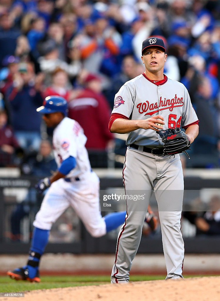Blake Treinen #64 of the Washington Nationals reacts as Curtis Granderson #3 of the New York Mets rounds third after hitting a solo home run in the eighth inning on October 4, 2015 at Citi Field in the Flushing neighborhood of the Queens borough of New York City.