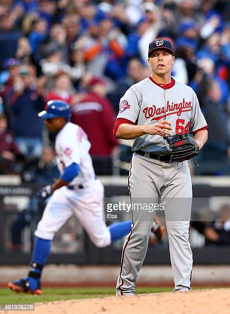 Blake Treinen of the Washington Nationals reacts as Curtis Granderson of the New York Mets rounds third after hitting a solo home run in the eighth...