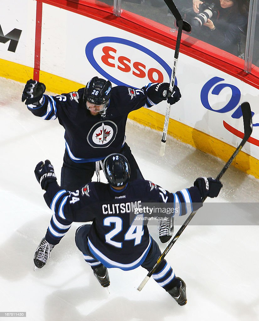 <a gi-track='captionPersonalityLinkClicked' href=/galleries/search?phrase=Blake+Wheeler&family=editorial&specificpeople=716703 ng-click='$event.stopPropagation()'>Blake Wheeler</a> #26 and <a gi-track='captionPersonalityLinkClicked' href=/galleries/search?phrase=Grant+Clitsome&family=editorial&specificpeople=4596638 ng-click='$event.stopPropagation()'>Grant Clitsome</a> #24 of the Winnipeg Jets celebrate a second period goal against the Montreal Canadiens at the MTS Centre on April 25, 2013 in Winnipeg, Manitoba, Canada.