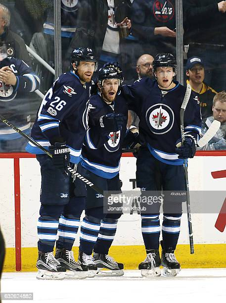 Blake Wheeler Bryan Little and Andrew Copp of the Winnipeg Jets celebrate a first period goal against the San Jose Sharks at the MTS Centre on...