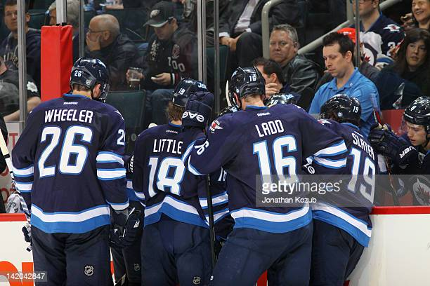 Blake Wheeler Bryan Little Andrew Ladd and Jim Slater of the Winnipeg Jets get instructions at the bench during a third period stoppage in play...