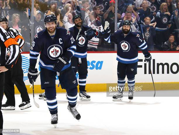 Blake Wheeler Dustin Byfuglien and Mark Stuart of the Winnipeg Jets are all smiles as they celebrate a third period shorthanded goal against the...