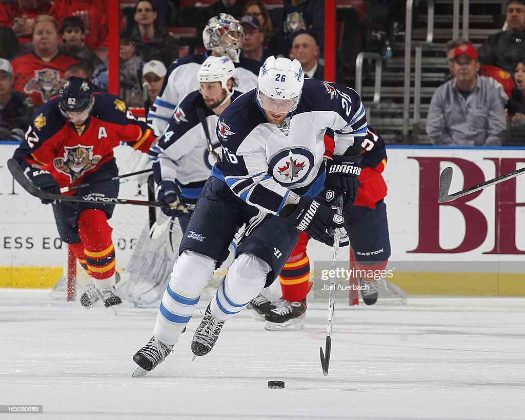 <a gi-track='captionPersonalityLinkClicked' href=/galleries/search?phrase=Blake+Wheeler&family=editorial&specificpeople=716703 ng-click='$event.stopPropagation()'>Blake Wheeler</a> #26 of the Florida Panthers skates with the puck up ice against the Winnipeg Jets at the BB&T Center on March 8, 2013 in Sunrise, Florida.