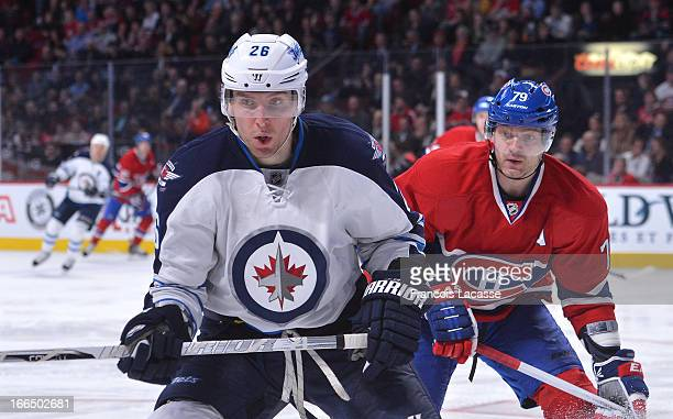 Blake Wheeler of the Winnipeg Jets and Andrei Markov of the Montreal Canadiens follow the play during the NHL game on April 4 2013 at the Bell Centre...