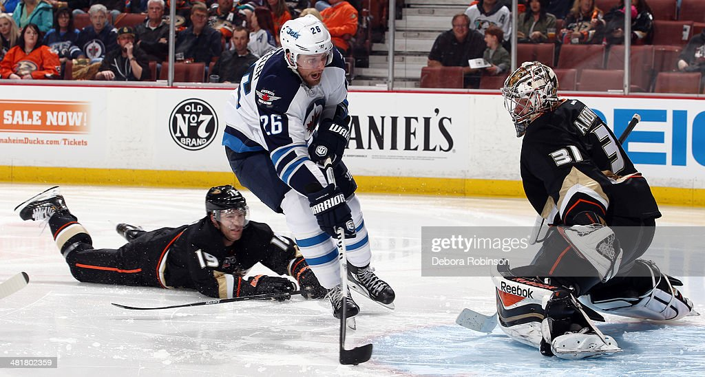 <a gi-track='captionPersonalityLinkClicked' href=/galleries/search?phrase=Blake+Wheeler&family=editorial&specificpeople=716703 ng-click='$event.stopPropagation()'>Blake Wheeler</a> #26 of the Winnipeg Jets attacks the net and scores in the second period against <a gi-track='captionPersonalityLinkClicked' href=/galleries/search?phrase=Frederik+Andersen&family=editorial&specificpeople=6605243 ng-click='$event.stopPropagation()'>Frederik Andersen</a> #31 of the Anaheim Ducks on March 31, 2014 at Honda Center in Anaheim, California.