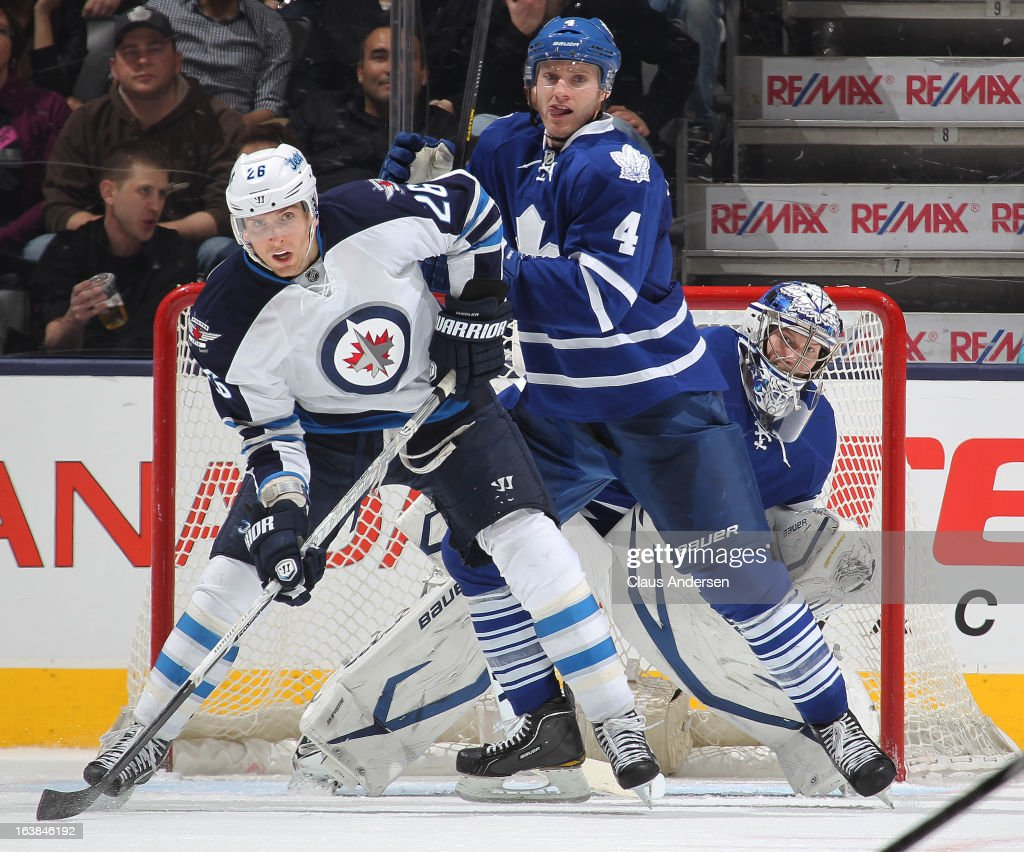 <a gi-track='captionPersonalityLinkClicked' href=/galleries/search?phrase=Blake+Wheeler&family=editorial&specificpeople=716703 ng-click='$event.stopPropagation()'>Blake Wheeler</a> #26 of the Winnipeg Jets battles with <a gi-track='captionPersonalityLinkClicked' href=/galleries/search?phrase=Cody+Franson&family=editorial&specificpeople=2125769 ng-click='$event.stopPropagation()'>Cody Franson</a> #4 of the Toronto Maple Leafs in a game on March 16, 2013 at the Air Canada Centre in Toronto, Ontario, Canada. The Jets defeated the Leafs 5-4 in an overtime shoot-out.