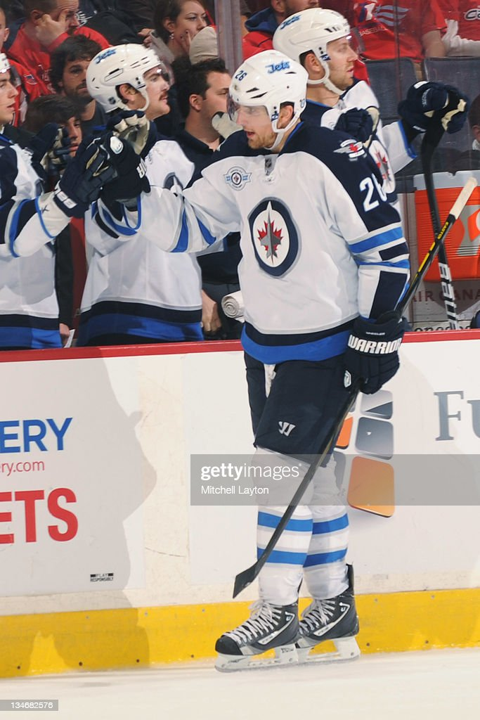 Blake Wheeler #26 of the Winnipeg Jets celebrates a goal during a NHL hockey game against the Washington Capitals on November 23, 2011 at the Verizon Center in Washington, DC. The Capitals won 4-3 in overtime.