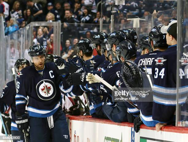 Blake Wheeler of the Winnipeg Jets celebrates his first period goal against the Colorado Avalanche with teammates at the bench at the MTS Centre on...