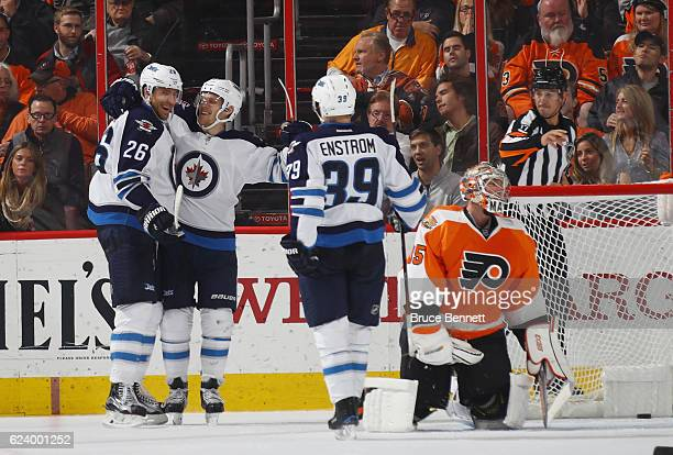 Blake Wheeler of the Winnipeg Jets celebrates his goal at 1719 of the second period against Steve Mason of the Philadelphia Flyers at the Wells Fargo...
