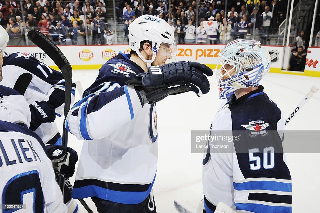 <a gi-track='captionPersonalityLinkClicked' href=/galleries/search?phrase=Blake+Wheeler&family=editorial&specificpeople=716703 ng-click='$event.stopPropagation()'>Blake Wheeler</a> #26 of the Winnipeg Jets congratulates teammate Chris Mason #50 following a 5-3 victory over the Anaheim Ducks at the MTS Centre on December 17, 2011 in Winnipeg, Manitoba, Canada.