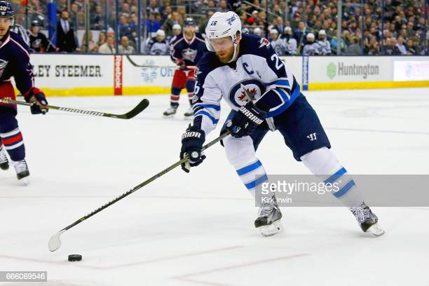 Blake Wheeler of the Winnipeg Jets controls the puck during the game against the Columbus Blue Jackets on April 6 2017 at Nationwide Arena in...
