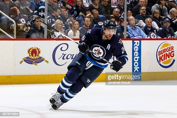 Blake Wheeler of the Winnipeg Jets follows the play down the ice during second period action against the Arizona Coyotes at the MTS Centre on January...