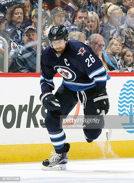 Blake Wheeler of the Winnipeg Jets follows the play down the ice during first period action against the Boston Bruins at the MTS Centre on October 17...