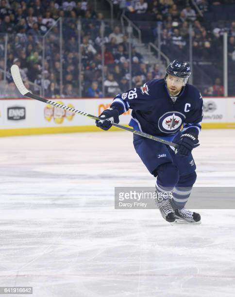 Blake Wheeler of the Winnipeg Jets follows the play down the ice during first period action against the Tampa Bay Lightning at the MTS Centre on...