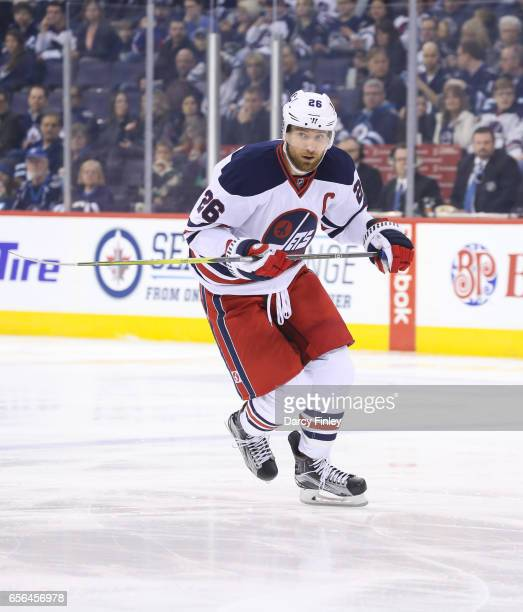 Blake Wheeler of the Winnipeg Jets follows the play down the ice during first period action against the Minnesota Wild at the MTS Centre on March 19...