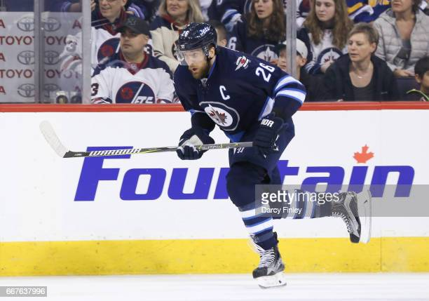 Blake Wheeler of the Winnipeg Jets follows the play down the ice during second period action against the Nashville Predators at the MTS Centre on...