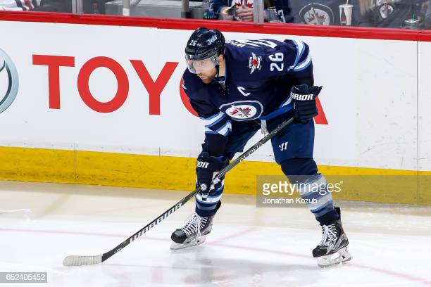 Blake Wheeler of the Winnipeg Jets gets set during a third period faceoff against the Pittsburgh Penguins at the MTS Centre on March 8 2017 in...