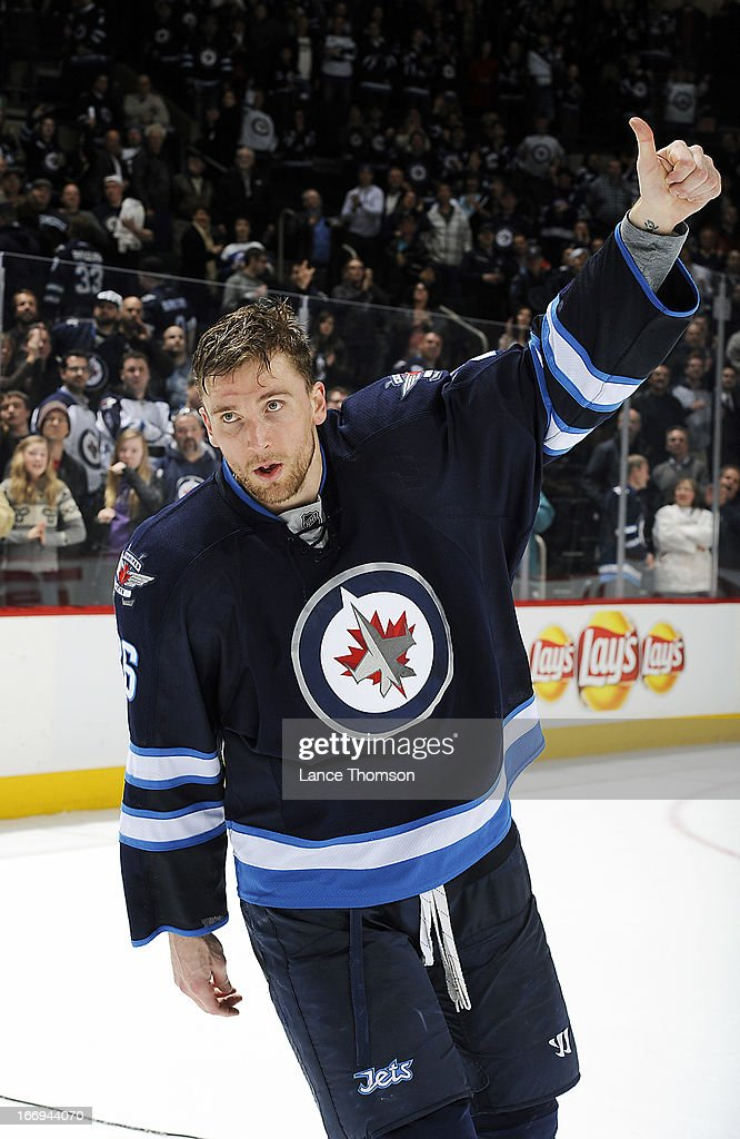 Blake Wheeler #26 of the Winnipeg Jets gives the thumbs up to the home fans after receiving first star honors following a 4-3 overtime victory over the Carolina Hurricanes at the MTS Centre on April 18, 2013 in Winnipeg, Manitoba, Canada.