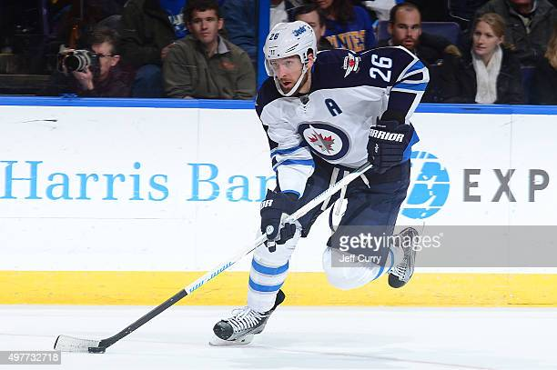 Blake Wheeler of the Winnipeg Jets handles the puck against the St Louis Blues on November 16 2015 at Scottrade Center in St Louis Missouri