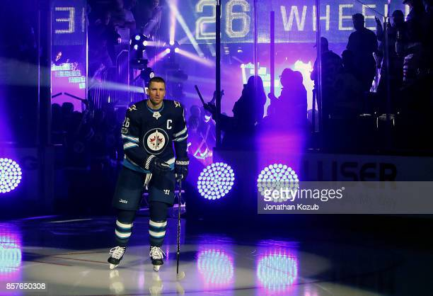 Blake Wheeler of the Winnipeg Jets hits the ice for the player introductions prior to puck drop in the home opener against the Toronto Maple Leafs at...