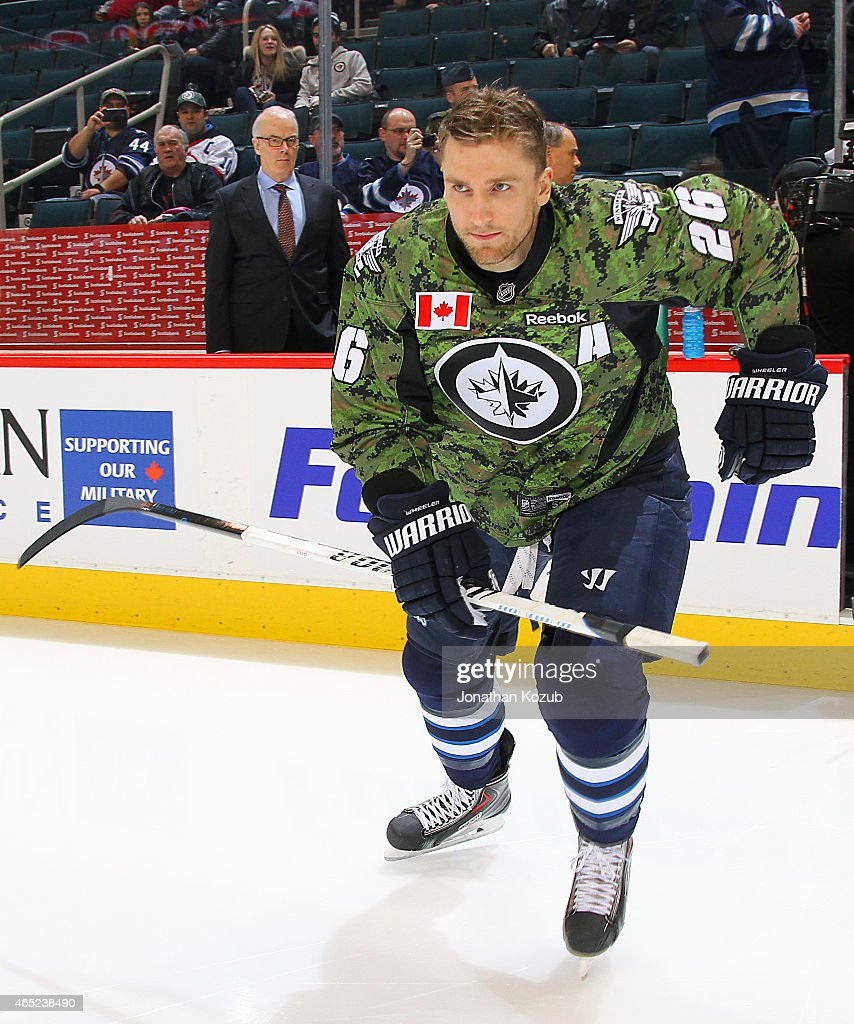Blake Wheeler #26 of the Winnipeg Jets hits the ice for the pre-game warm up donning a special commemorative jersey in honor of Canadian Armed Forces Appreciation Night prior to NHL action against the Ottawa Senators on March 4, 2015 at the MTS Centre in Winnipeg, Manitoba, Canada.